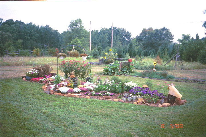One of back yard gardens that once was just overused veggie garden sandy dirt.  Mostly annuals here.