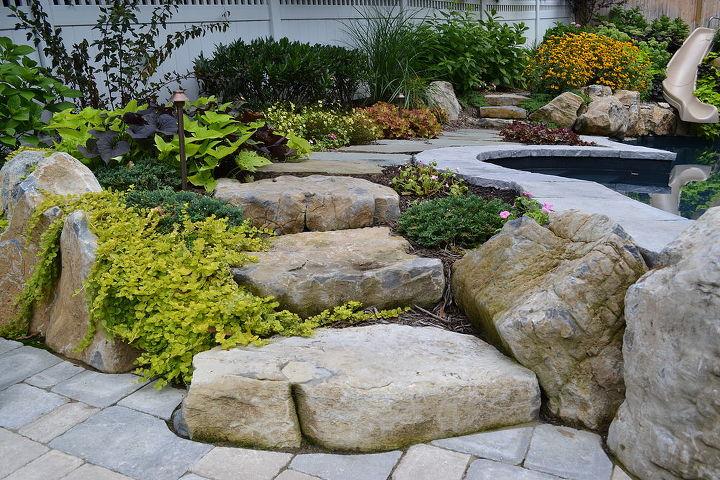 Moss rock boulder steps and landscaping