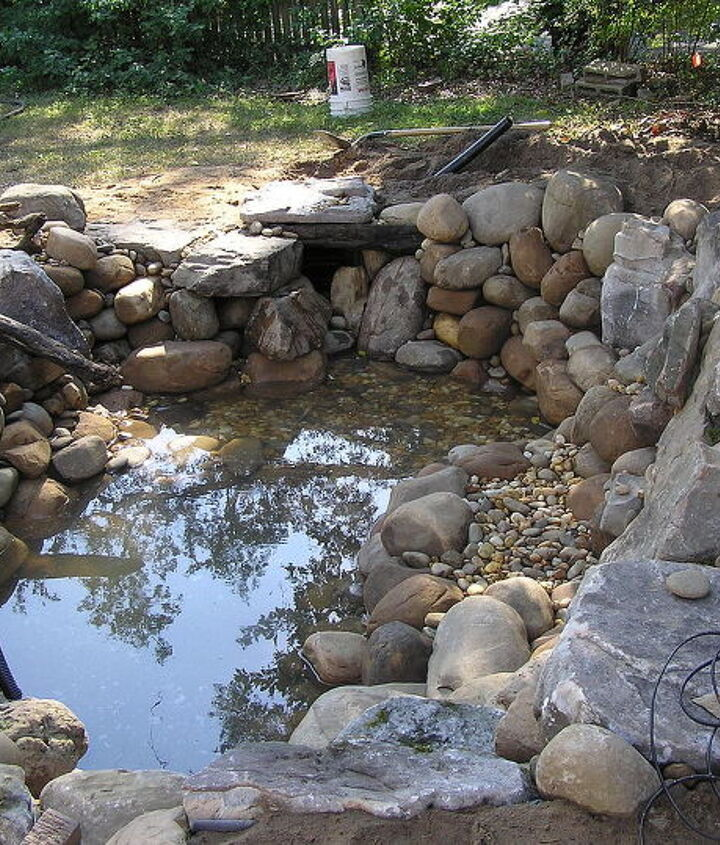 """Next, we gravel all the points in between and around our boulders and rocks.. the gravel """"locks"""" the boulders and rock into place as well as it serves as surface area for beneficial bacteria growth. Great for aquatic planting too."""