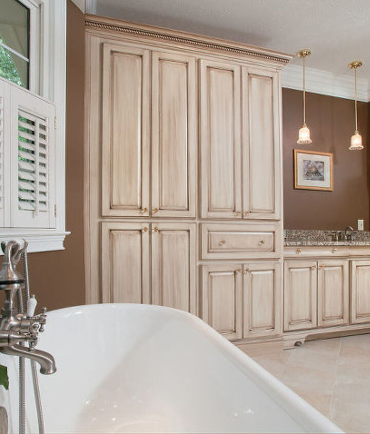 This is the view when soaking in the double slipper tub. There is an abundance of storage cabinetry for linens, the television, and a built-in safe.  In the middle is the coffee bar with its own sink and pendant lighting.