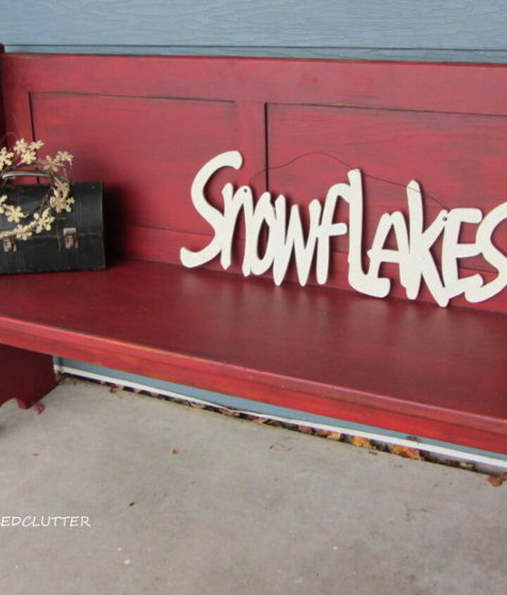 """I placed a """"Snowflakes"""" glittered sign and a vintage lunch box with snowflake wreath on the pew."""