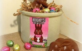 2 faux chocolate bunnies, crafts, easter decorations, seasonal holiday decor, I Mod Podged the candy wrapper on the crock and filled it with foil wrapped chocolate eggs and shredded paper