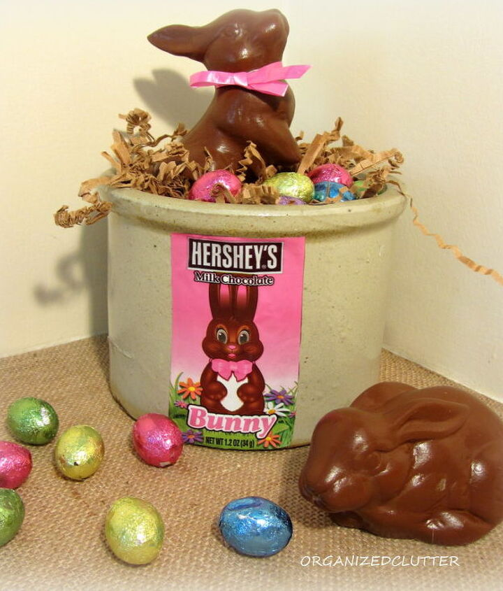 I Mod Podged the candy wrapper on the crock and filled it with foil wrapped chocolate eggs and shredded paper.