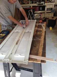 Joining plastic garage sale shutters together with 1 x 2 and nuts/bolts for strength to make our DIY Shutter Towel Rack.