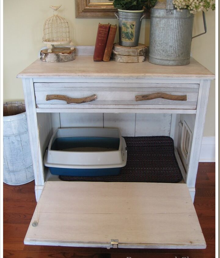 The cabinet was gutted  with the drawer fronts mounted on wood and hinged to open freely to clean the litter box