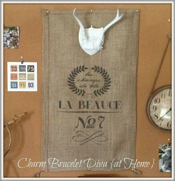 This burlap reproduction French grain sack seemed like the perfect place to hang the antlers.