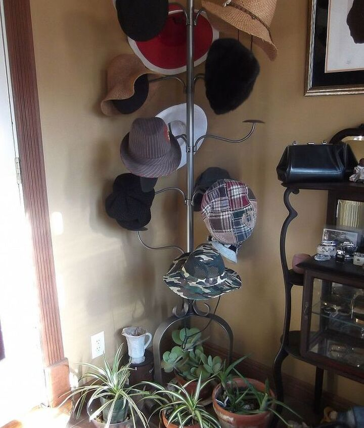 She snagged this cute hat rack at a Store-Closing sale when they were selling the display items.  I see her plants resting nicely underneath