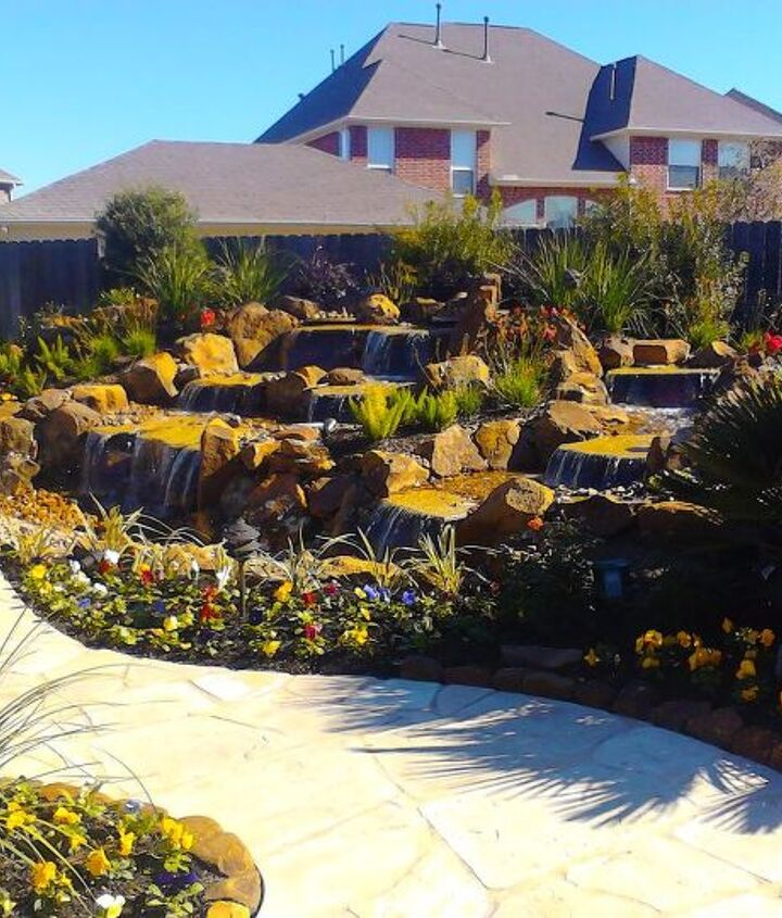 Completed water feature with landscaping and pathway