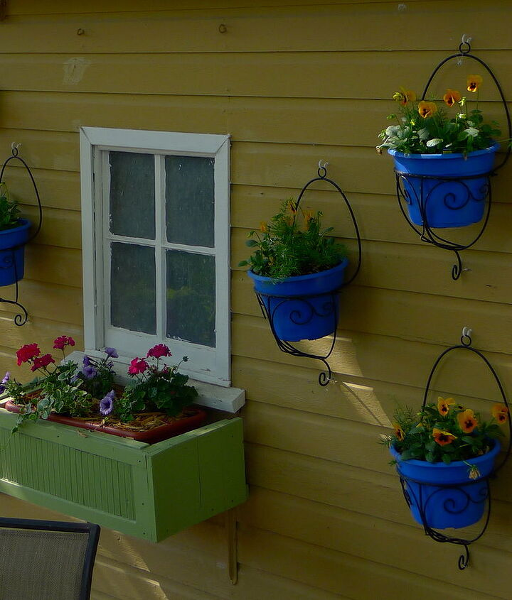 Hangers on the shed with spray painted pots.