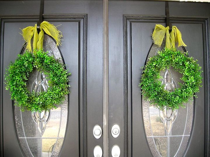 At first, I just hung the wreaths but they seemed to need a little something more.