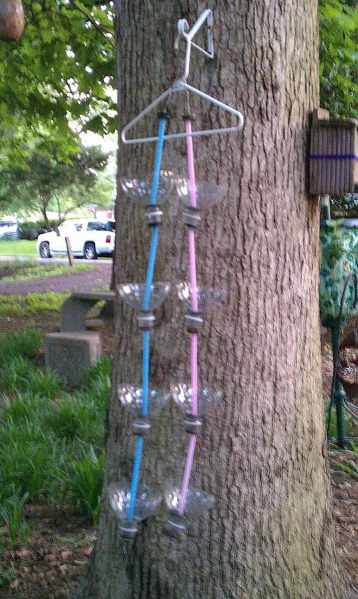 This gives you a better idea of what they look like. There are 2 rain chains hanging from a plastic coat hanger.There are 4 cups in each rain chain.