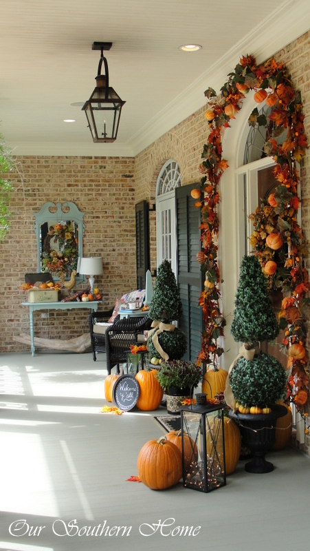 Deep southern front porch decorated for fall