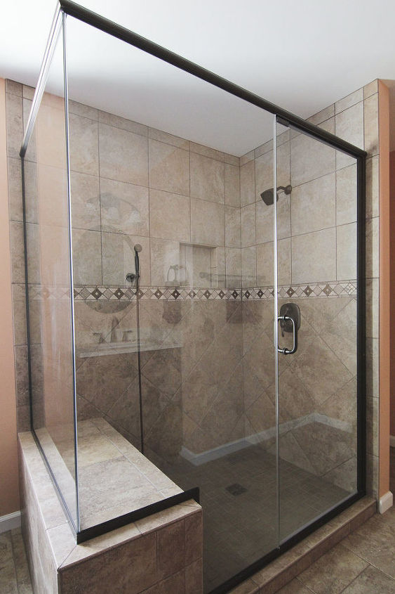 Semi- Frameless shower with brushed nickel finish.  Features Moen fixtures. Recessed soap/ shampoo niche in the wall.