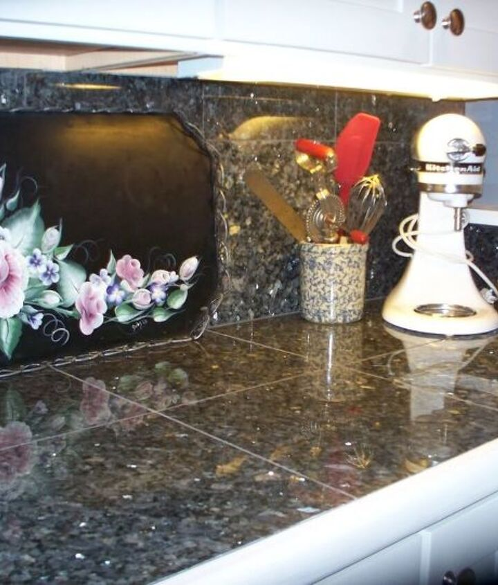 The countertops are Blue Pearl Granite TILES, saved thousands over slab granite. The tray was an old grey metal one my talented sister painted for me. Note the modern KitchenAid next to hand crank egg beater in crock.