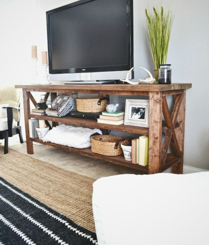 The TV stand is long & works great in open floor plans or large living areas. You can style this piece many different ways, but we went for a cozy eclectic look & feel.