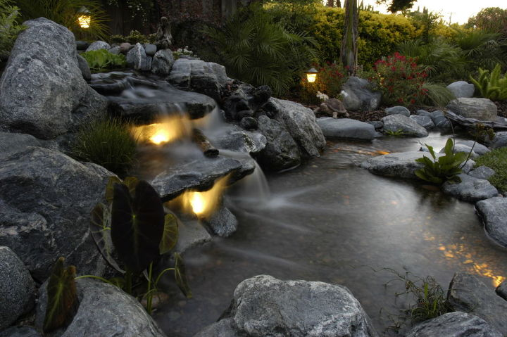 underwater lighting in a waterfall, outdoor living, ponds water features, Underwater Lighting Brings a new life to a waterfall after dark