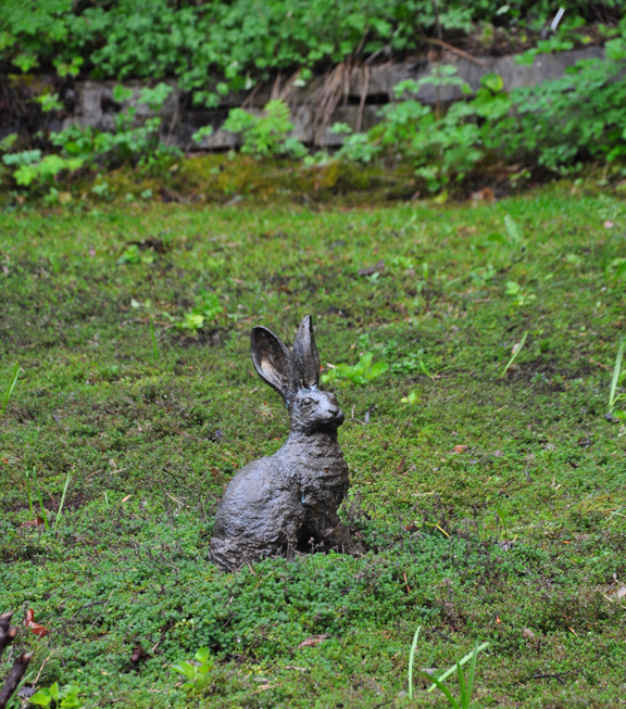 """A rabbit ornament sits in the middle of a thyme """"lawn"""" in the """"Fragrant Garden""""."""