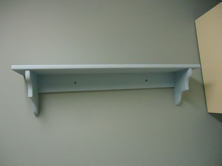I painted this found shelf with Annie Sloan 'Louis Blue.' Looking for hooks to add to this.