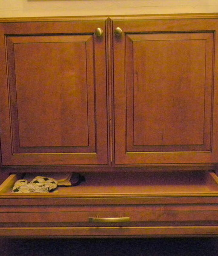 Sink base with drawer extended. Great location for dish towels, but we'll loose a little space underneath once the undermount sink goes in.