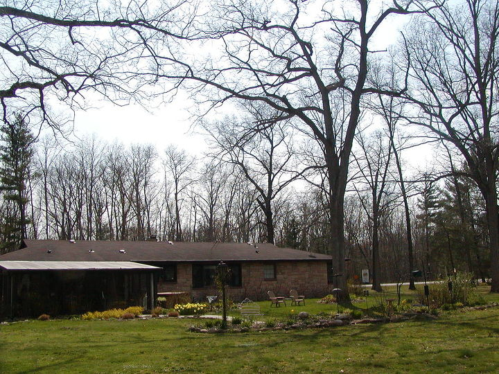 The Small House Under the White Oak Trees with bird feeding bed to the right.
