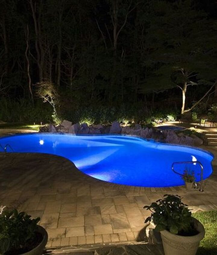 LOw voltage landscape lighting and LED pool lighting make this pool awesome at night http://www.deckandpatio.com/awards/Awards2008.html
