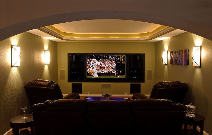 Custom Theater Room with trayed ceiling, inset crown lighting, recessed TV niche, and smoked glass niche components