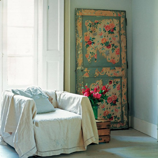 A decoupaged door used as a focal point in a room. If you love crafts, this is the right project for you! From Disfunctionaldesigns.blogspot.co.uk