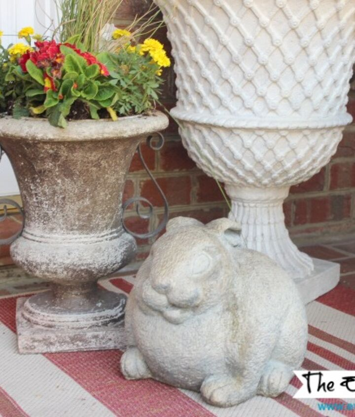 Garden bunnies and flower-planted urns stand guard on each side of the front door.