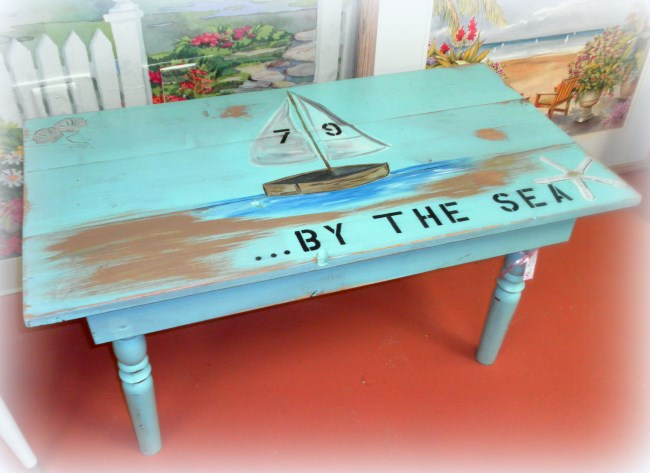 I built this coffee table from pine boards and old table legs I had on hand. I gave it a beachy look with some decorative painting.