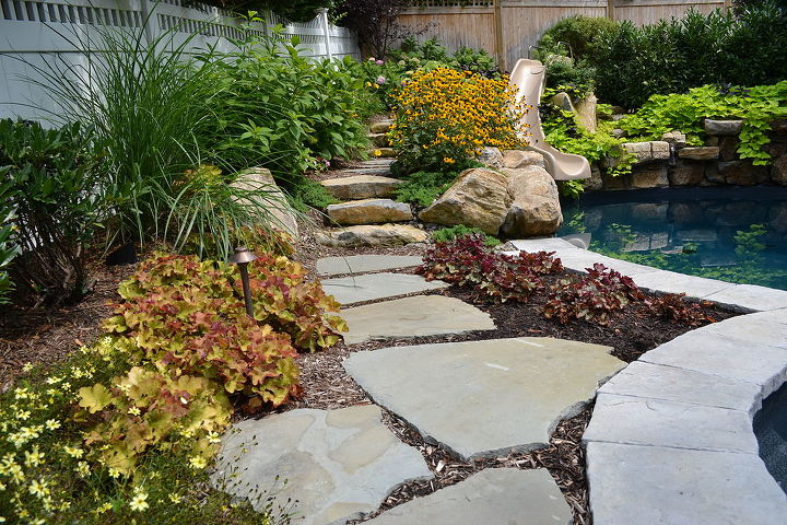 Stepping stone path through garden at the pool