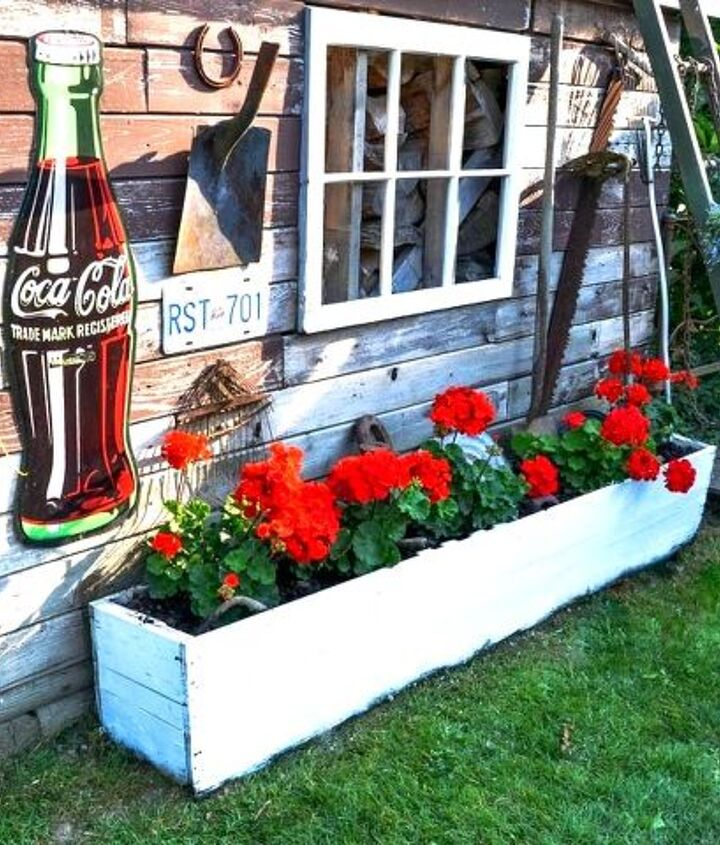 Bright, red geraniums are doing awesome in this old crate flowerbox.