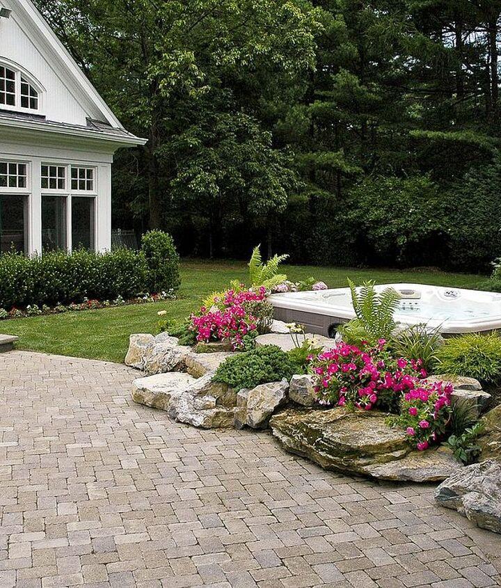 Landscaped Hot Tub surround at the edge of a paver patio www.longislandhottub.com