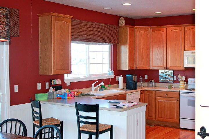We continued it and replaced the old dated wooden paneling that originally surrounded the kitchen peninsula.