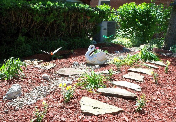 Created a little dry creek bed in another area near the house where water used to gather