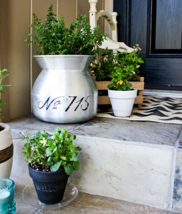 Freshly potted flowers and our address stenciled on the pot add so much to the steps.