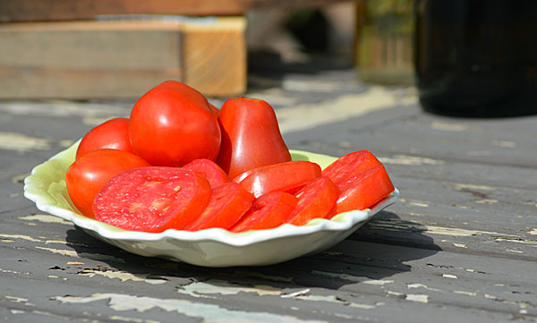 Wash tomatoes and pat dry. Slice a minimum of  1/4 inch thick, Keeping in mind that the thicker the tomato, the longer it will take to dry.