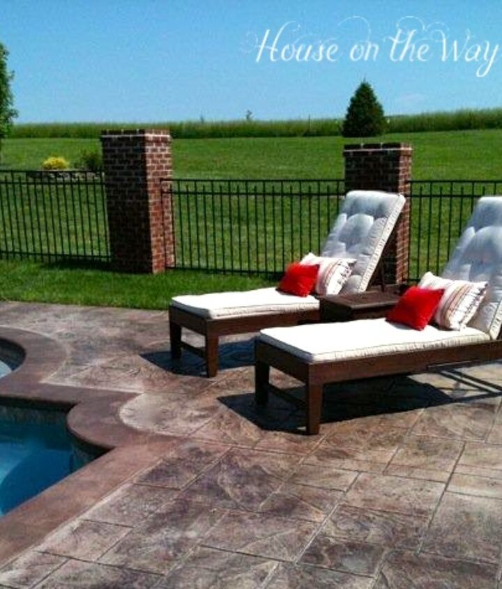Chaise lounge chairs with oatmeal color cushions with throw pillows