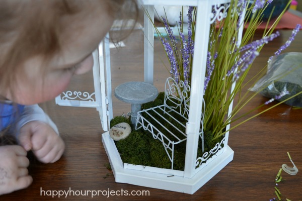 I added preserved moss and fake grasses, and my daughter added miniatures.  She LOVES it!
