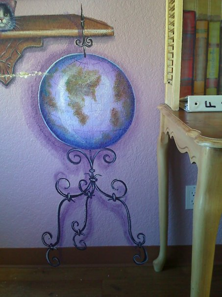 I felt no library was complete without a globe I painted for exploring the world outside.