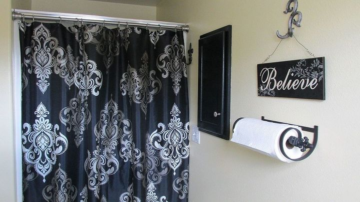 AFTER: Master bath. We have shower doors but I love a cute shower curtain.