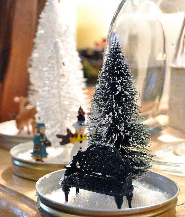 add another layer of glue and add faux snow and sparkly glitter to the inside of the base. Let the jar sit out a few days so the glue dries and moisture doesn't get caught in the jar when you put the lid back on.