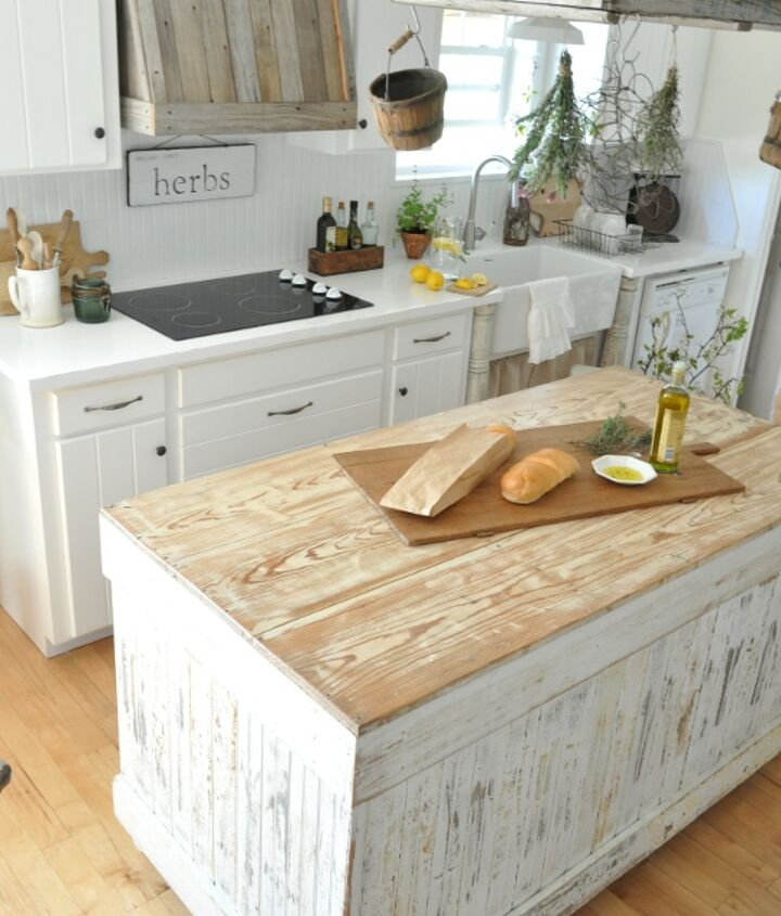 White countertops contrast with wooden tones