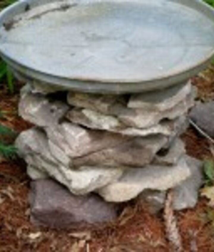 When the stacked stone is the height desired, add the galvanized lid. One down and two more to go!