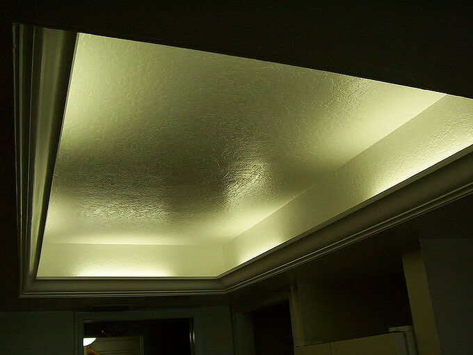 what to do with that 1980 s style kitchen lighting, kitchen design, lighting, Florescent or LED lights can be installed behind the crown molding for an elegant look