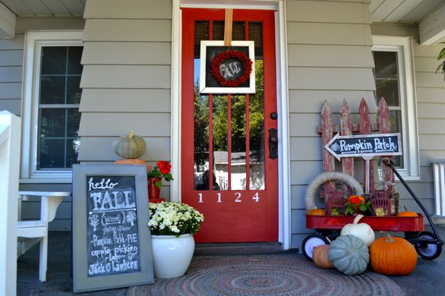 A very fall porch, with my favorite things - pumpkins, chalkboards, mums and a red wagon.