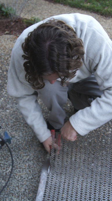I put my hubby to work cutting the metal grate for the door panel. (Thanks, hubby.)