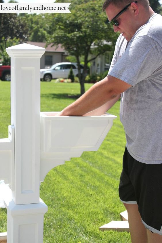 Using the hardware provided, we added the mailbox support arm & flower box to the new post.