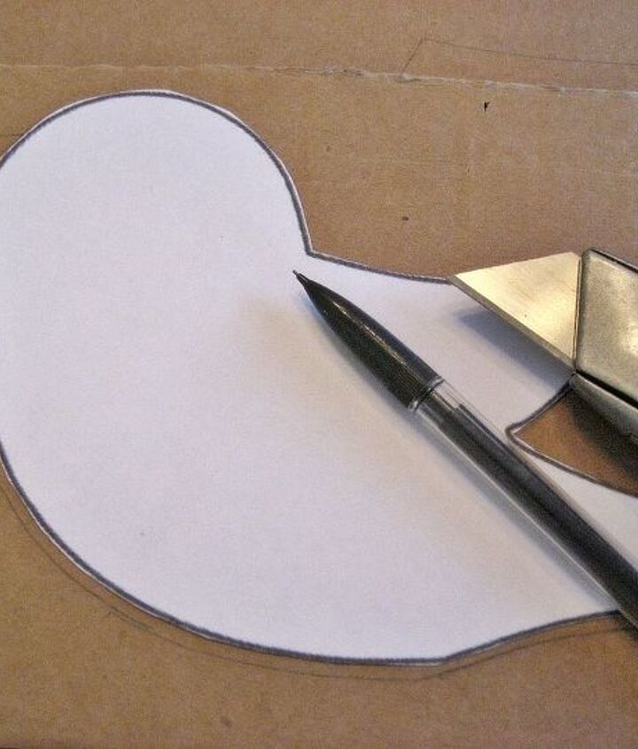 Start by cutting bird shapes from an old cardboard box. A link to the bird template is on my blog.