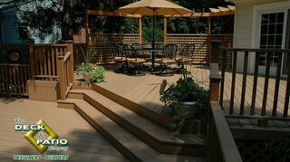 q new deck, decks, This is Trex accents It is a composite deck which can fade a bit but does keep it s color it will need annual cleaning