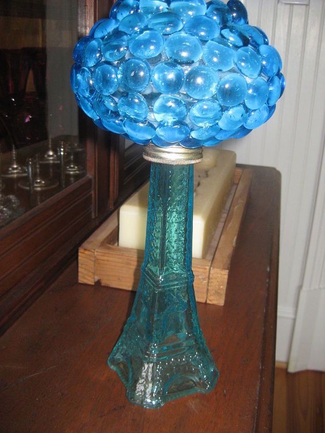 Loved this blue glass that I put on a kerosene lamp section. Haven't found the base I want to put it on yet.